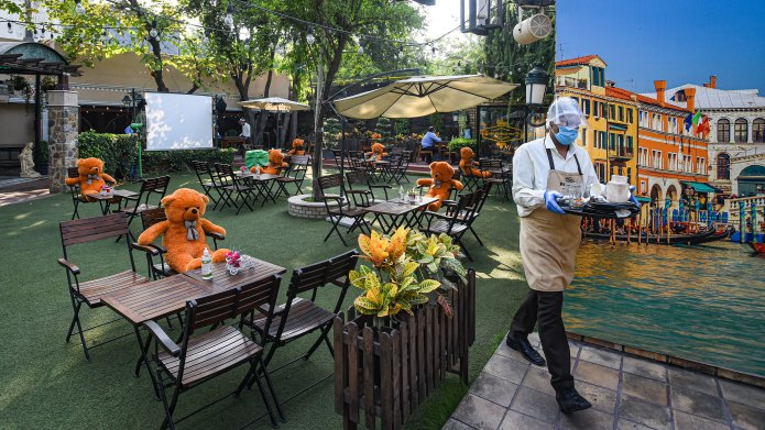 Teddy bears are seen at tables at a restaurant to maintain social distancing in New Delhi, India, on September 25.