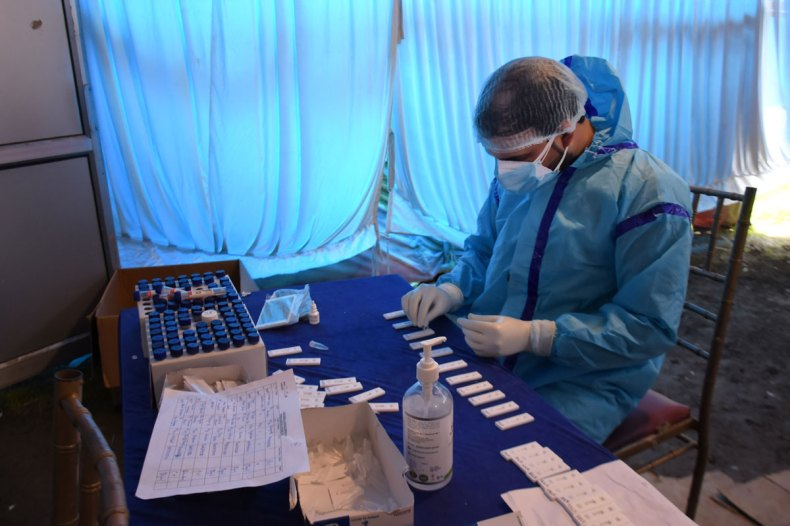 A health worker prepares a Covid-19 test sample at a testing centre in Srinagar, India on April 21.