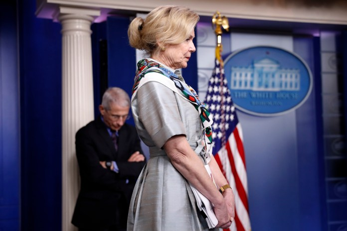 Dr. Deborah Birx, White House Coronavirus Response Coordinator, and Dr. Anthony Fauci, Director of the National Institute of Allergy and Infectious Diseases, listen during a briefing on the White House coronavirus on 9 April.