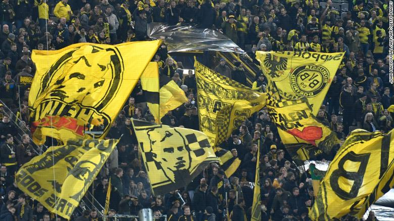 Dortmund fans wave flags prior to the UEFA Champions League round of 16 second-leg football match Tottenham Hotspur on March 5, 2019 in Dortmund, western Germany.