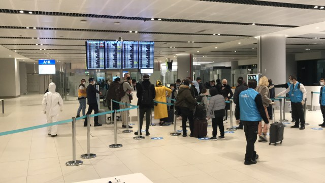 Passengers arrive at Istanbul airport in Turkey on December 21.