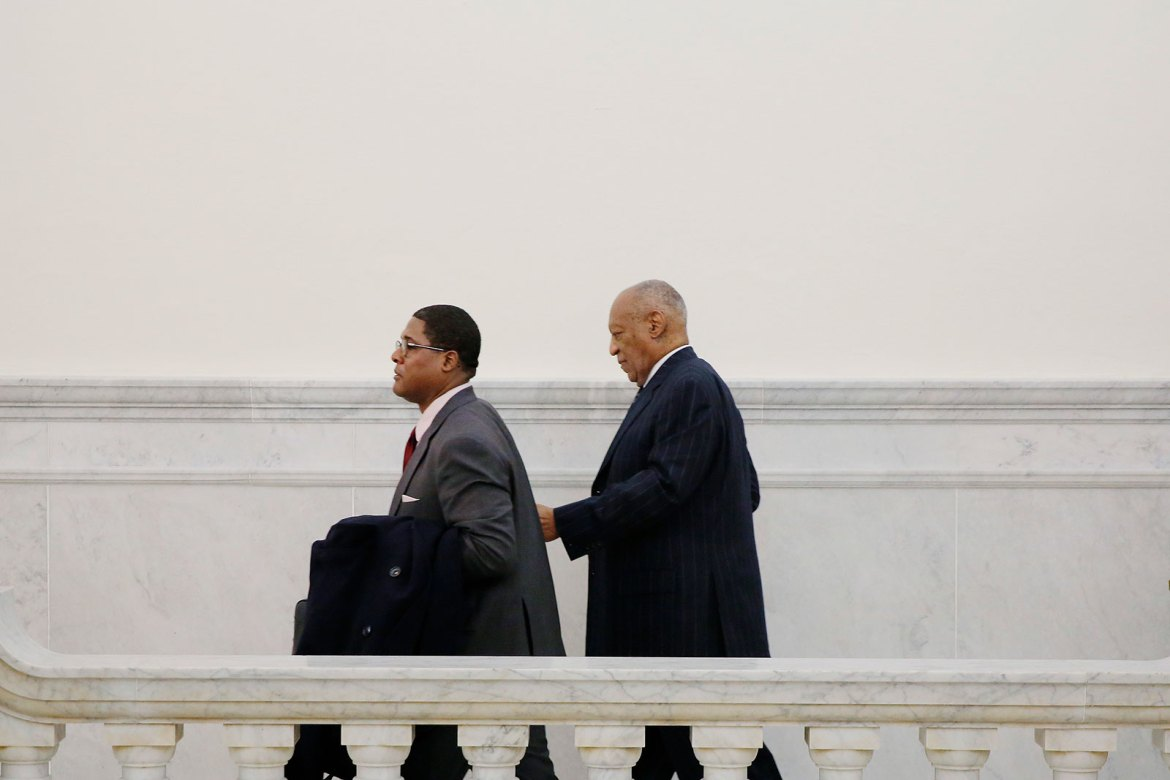 Bill Cosby, right, walks through the Montgomery County courthouse in 2018.