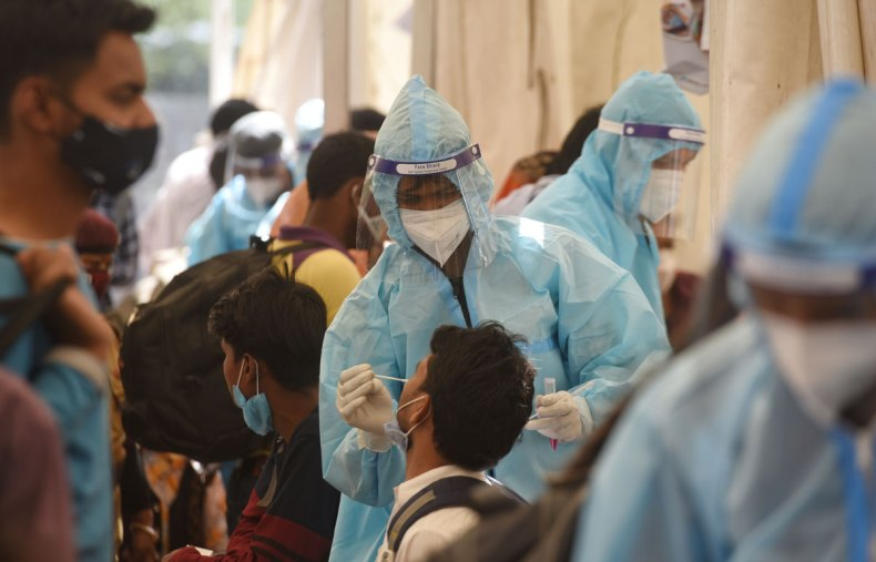 A health worker collects a swab sample for Covid-19 testing at Anand Vihar Bus Terminal on April 3 in New Delhi, India.