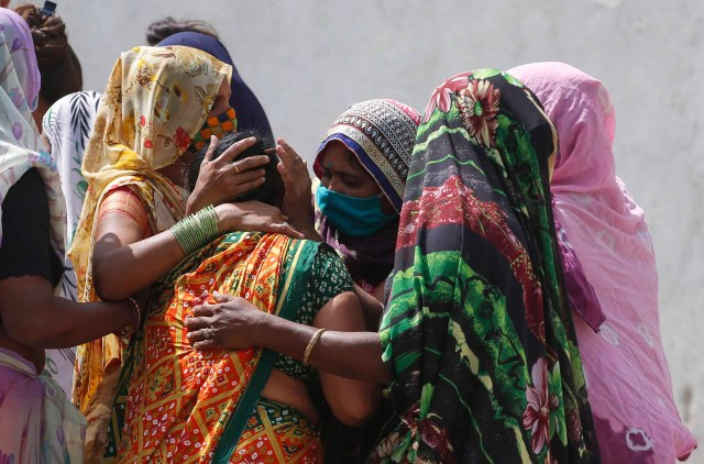 Relatives of a patient who died of Covid-19 mourn outside a hospital in Ahmedabad, India, on April 17.