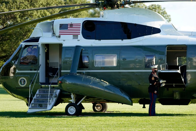The pilot of Marine One wears a face mask as President Donald Trump prepares to leave the White House to go to Walter Reed National Military Medical Center on October 2 in Washington, DC.