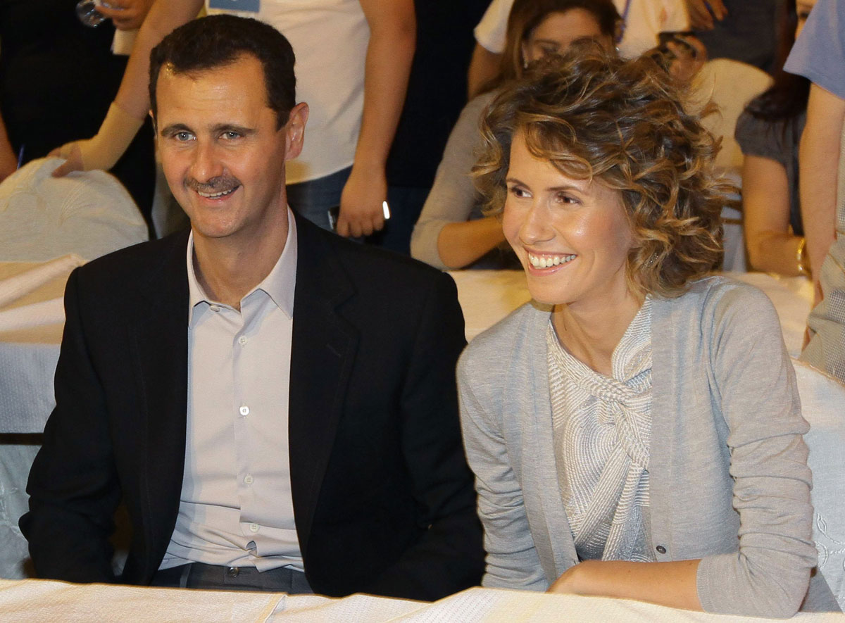 Syrian President Bashar Assad and his wife, Asma, are seen in a hotel in Damascus on September 5, 2010.