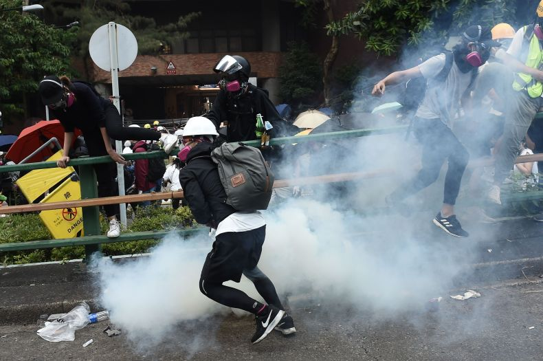 Police fire tear gas as protesters try to leave Hong Kong Polytechnic University on November 18, 2019.