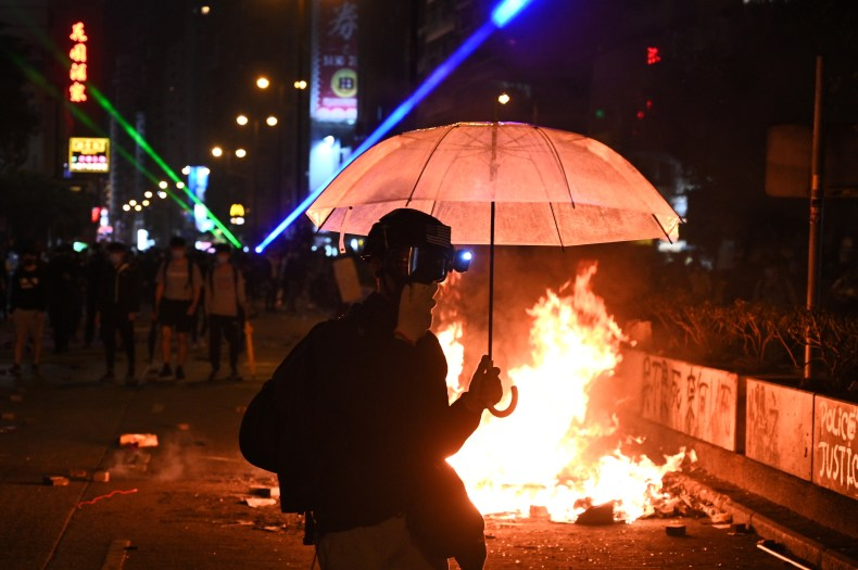 Protesters set a fire as they march to Hong Kong Polytechnic University in Hong Kong on Monday.