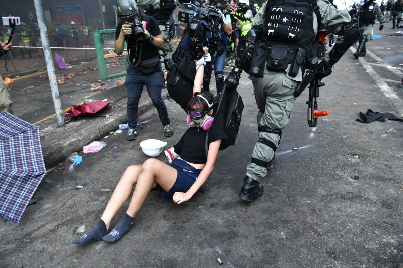 Protesters are detained by police near the Hong Kong Polytechnic University on November 18, 2019.