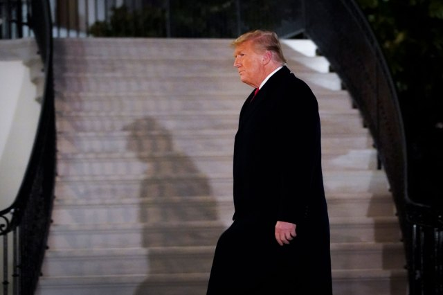 President Trump arrives at the White House on January 12.