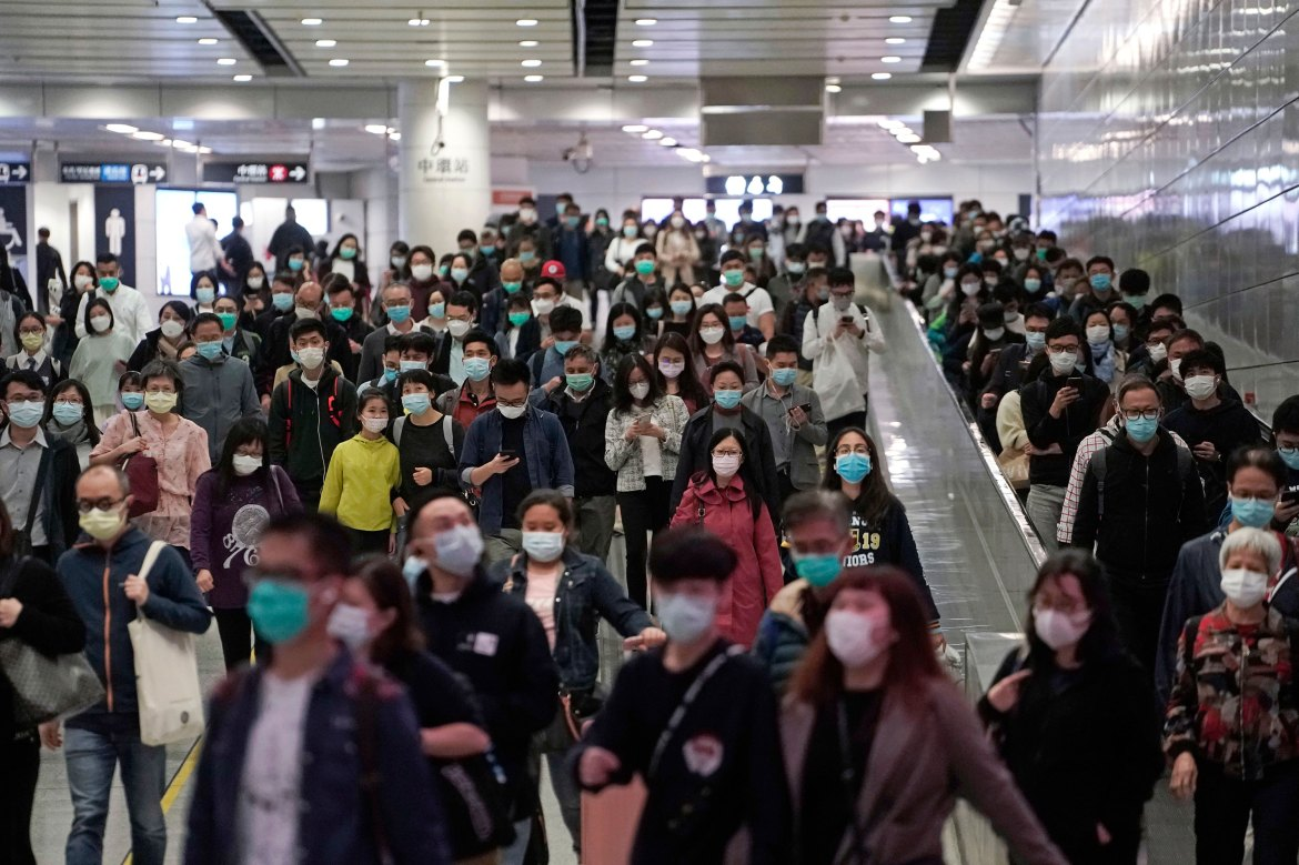 Commuters wear face masks during rush hour inside a subway station in Hong Kong, March 11.
