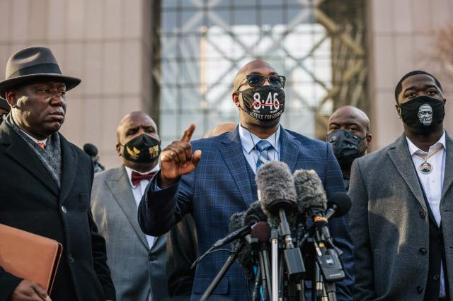 Philonise Floyd, brother of George Floyd, speaks alongside attorney Ben Crump, left, and Brandon Williams, nephew of George Floyd, right, during a news conference outside the Hennepin County Government Center on March 29 in Minneapolis, Minnesota.