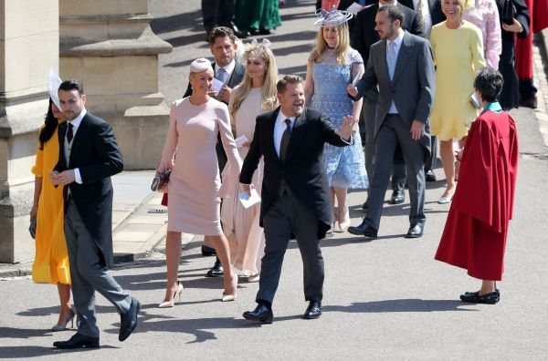 James Corden and Julia Carey arrive for the wedding ceremony.