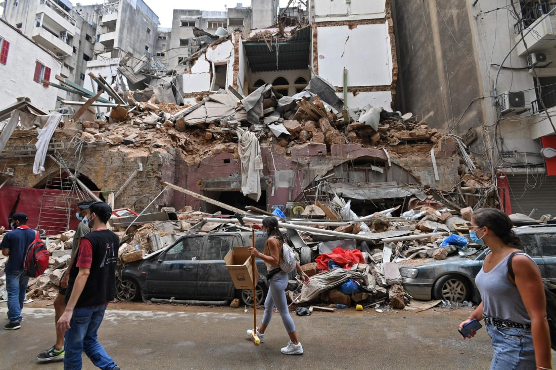 Lebanese volunteers clear the rubble in the devastated Gemmayzeh neighbourhood, on August 7.
