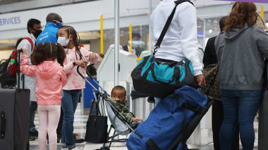 Travelers arrive for flights at O'Hare International Airport in Chicago on March 16, 2021. US airports are seeing pandemic-era record numbers of passengers.