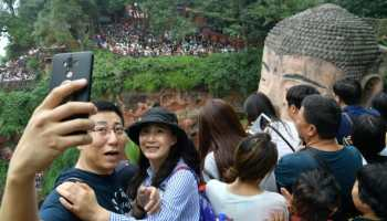 Tourists crowd the Leshan Giant Buddha in China's Sichuan province during the National Day holiday in 2019.