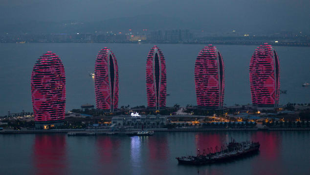 Buildings stand illuminated at night on Phoenix Island, a luxury resort in Sanya.
