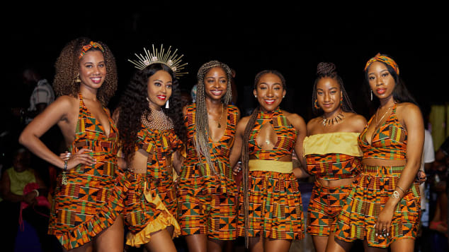 Festival attendees in matching Kente at Afrochella.
