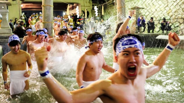 """Men in loincloths bathe in cold water to purify their souls as part of the """"Hadaka Matsuri"""" (Naked Festival) at Saidaiji Temple on February 15, 2020 in Okayama, Japan."""