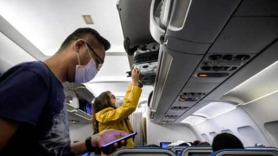 Harvard researchers described wearing masks as a critical part of keeping travelers safe in aircraft cabins, but stopped short of calling for a government mask mandate onboard flights.