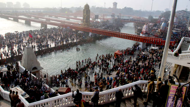 Indian Hindu devotees gather at the River Ganges during Makar Sankranti, a day considered to be of great religious significance in Hindu mythology, on January 14, 2021.