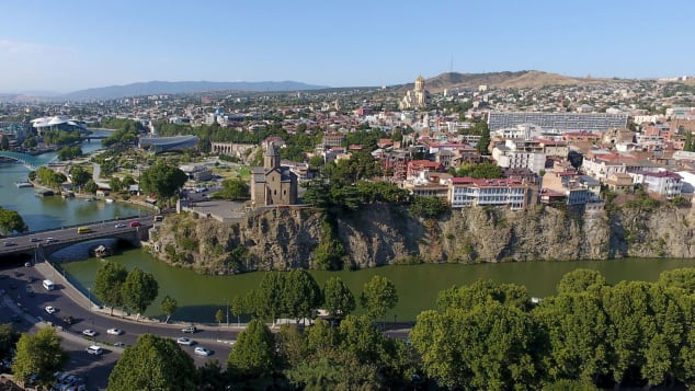 A picture taken with a drone on August 23, 2017 shows a view of the Georgian capital of Tbilisi.