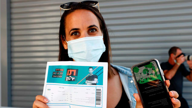 """Israel's """"green pass"""" digital vaccination certificate is being used to allow venues and events to reopen."""
