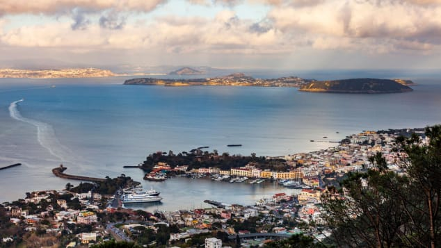 The port of the volcanic island of Ischia (front) and the island of Procida (back) are pictured in the Bay of Naples, off Italy's western coast on the Tyrrhenian Sea, on March 4, 2019. (Photo by Laurent EMMANUEL / AFP) (Photo credit should read LAURENT EMMANUEL/AFP via Getty Images)