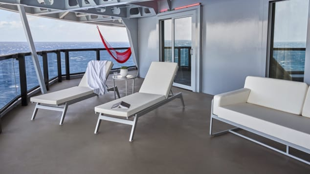Suits feature private sun loungers and an outdoor terrace couch.