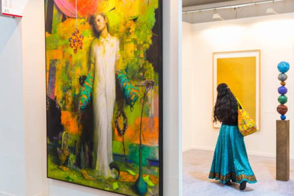A woman roams through last year's India Art Fair.