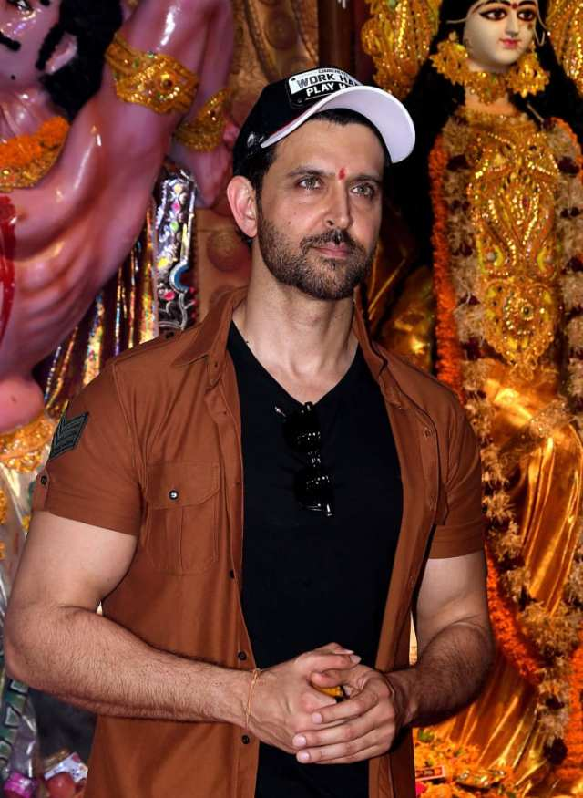 Bollywood actor Hrithik Roshan attends Hindu religious celebrations in Mumbai on October 7, 2019.