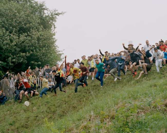Every year, a village in Gloucestershire hosts an annual cheese-rolling competition, in which participants chase a wheel of cheese down a steep hill.