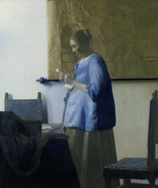 """""""Woman in Blue Reading a Letter"""" illustrates many of the same themes: a solitary figure reading a letter in a familiar domestic space, lit by the light of a window to the left."""