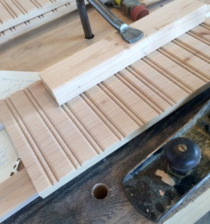 Raise the edge you want to joint off your workbench a little