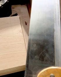 Finishing the cut with a hand saw