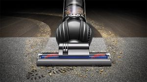 Overhead view of Dyson DC66 Animal vacuum cleaner across hard floor and carpet
