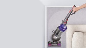 Aerial view of Dyson DC66 Animal vacuum cleaner on carpet going round corner