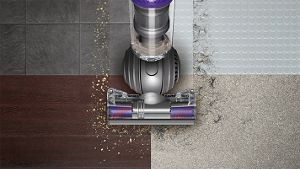 Aerial view of Dyson DC66 Animal vacuum cleaner on multiple floor types