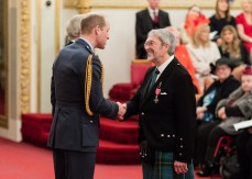 Alistair Newton receiving the medal from Prince William