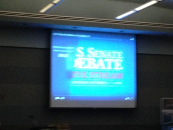 A blurry image of the US Senate Debate screen.