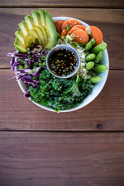 Spicy bowl with greens, scallions, red cabbage, sesame seeds, avocado, pickled carrots, lime and house sauce.