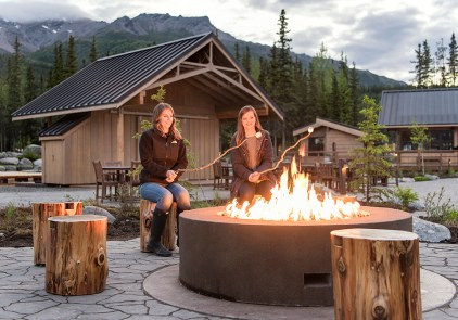 Property - Guests around firepit at Denali Square at McKinley Chalet mc_04