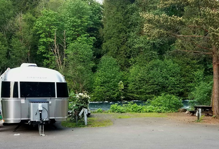 The silver cloud parked by the McKenzie River