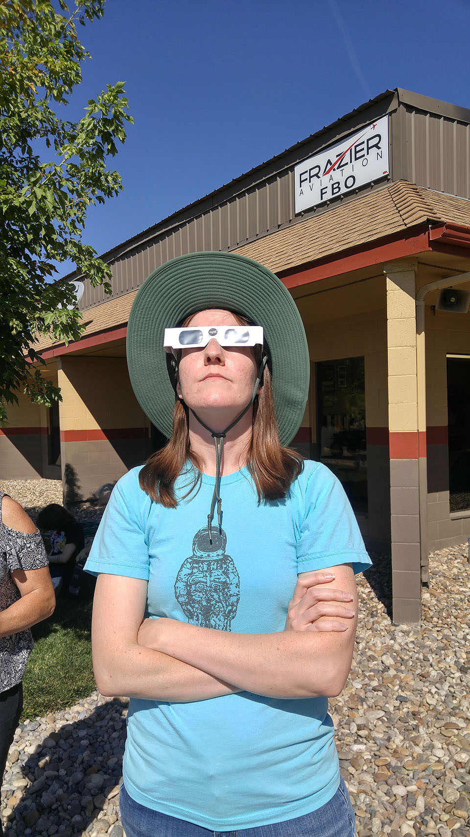 My wife safely watching the eclipse with her eclipse glasses.