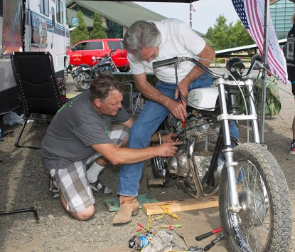 "Denny ""The Flying Irishman"" Edwards, 72, right, gets help from Ben Brown, left, while preparing his 1966 Triumph motorcycle for his first motorcyle jump since retireing 32 years ago. Photographed at the Evergreen Space Museum, in McMinville, Ore, Saturday Aug, 12, 2017."