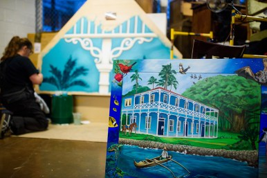 """The panel and the headboard that goes with it that Eona Skeltor is working on in the background. This piece is called """"Pioneer Inn"""". Both pieces will be used in one of McMenamins rooms In Kalama, WA."""