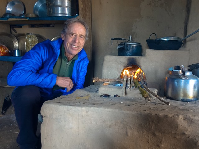 Jim next to a smokeless cookstove in rural Nepal.
