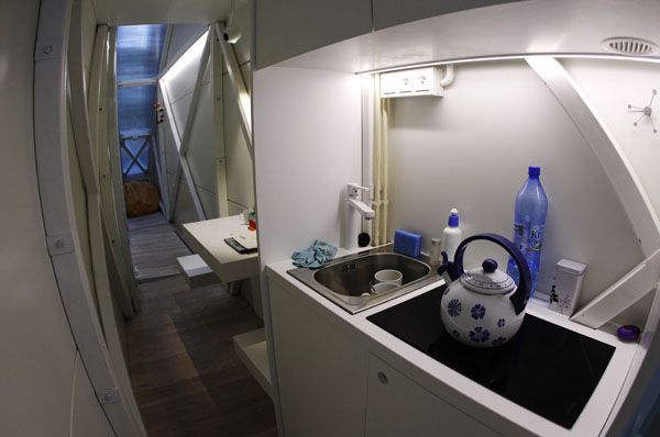 A view of the kitchen and living room in one of the world's narrowest buildings in Warsaw