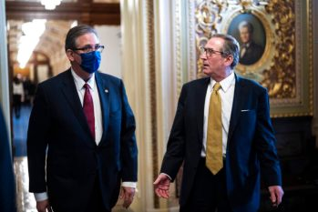 Bruce Castor and Michael van der Veen, lawyers for former President Donald Trump, walk back to their meeting room during a break through the Senate Reception room in the Capitol on the fourth day of the Senate Impeachment trials for former President Donald Trump on Capitol Hill, Friday, Feb 12, 2021 in Washington. (Jabin Botsford/The Washington Post via AP, Pool)