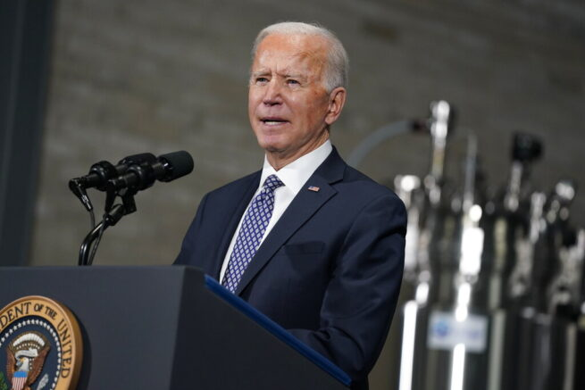 President Joe Biden speaks after a tour of a Pfizer manufacturing site, Friday, Feb. 19, 2021, in Portage, Mich. (AP Photo/Evan Vucci)